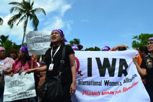 IWA Chairperson Liza L. Maza speaking at the all women lightning rally at the WTO 9th Ministerial Conference in Nusa Dua, Bali, Indonesia 4 December 2013